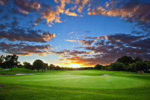 A sunset on a golf course in Australia