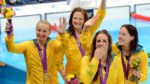 Australias olympic swimming team holds their medals