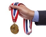 A man holding an Olympic medal